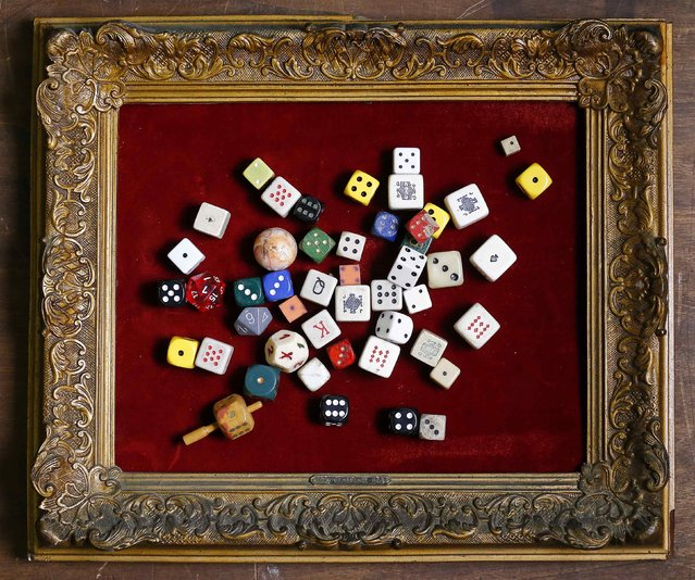 Dice are displayed in an old frame in the Museum of Domenico Agostinelli in Dragona, near Rome October 30, 2014. (Photo by Tony Gentile/Reuters)