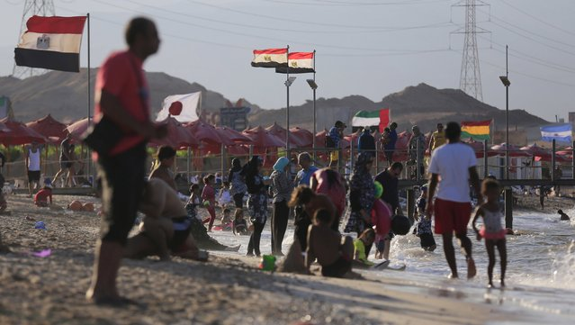 People enjoy the beach towards the end of summer vacation for schools at El Ain El Sokhna in Suez, east of Cairo, Egypt, September 5, 2015. (Photo by Amr Abdallah Dalsh/Reuters)