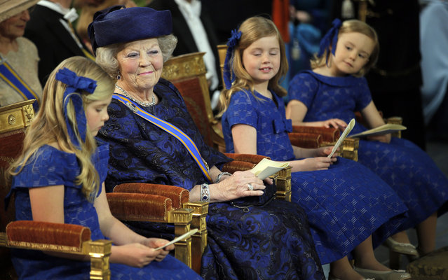 The former queen and her granddaughters Amalia (left), Ariane and Alexia (right) can be seen here awaiting the grand entry of the royal couple at the church, on April 30, 2013. (Photo by Peter Dejong/Reuters)