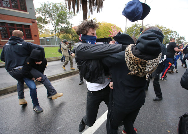 """A strong and diverse selection of images in this body of work show Alex Coppel's technical skill and storytelling ability. He captures action in the sporting arena and violent clashes in the streets, dramatic weather and quirky daily life"". Here is a shot of a clash between United Patriots Front and anti racism protestors in Coburg – it shows a UPF member appearing to punch a woman. (Photo by Alex Coppel/The Walkley Foundation)"