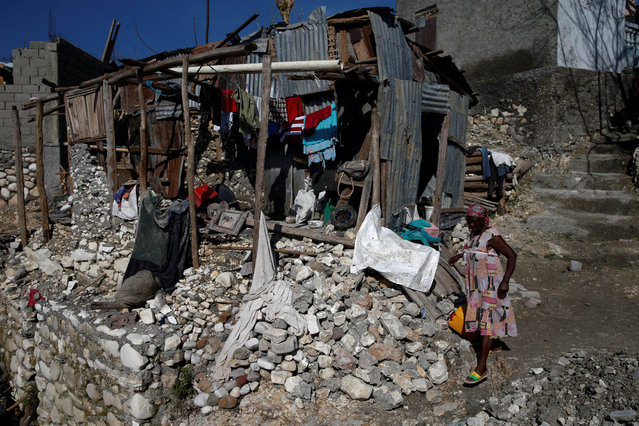 A woman walks next to her destroyed house after Hurricane Matthew hit Jeremie, Haiti, October 15, 2016. (Photo by Carlos Garcia Rawlins/Reuters)