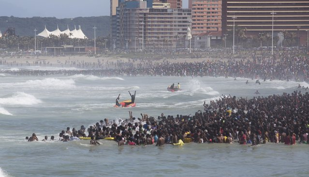 Thousands of people celebrate New Year's Day on a beach in Durban, South Africa January 1, 2015. (Photo by Rogan Ward/Reuters)