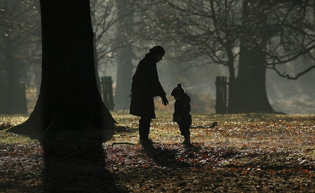 People walk in Dunham park near Altrincham, northern England December 29, 2014. (Photo by Phil Noble/Reuters)