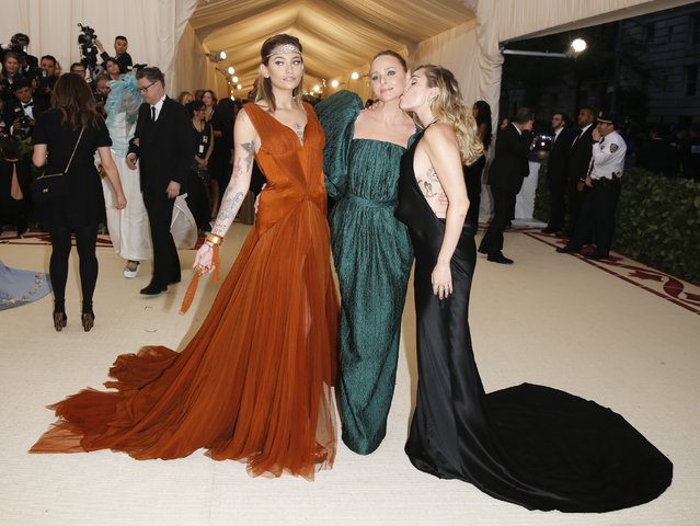 Paris Jackson, Stella McCartney and Miley Cyrus attend The Metropolitan Museum of Art's Costume Institute benefit gala celebrating the opening of the Heavenly Bodies: Fashion and the Catholic Imagination exhibition on Monday, May 7, 2018, in New York. (Photo by Carlo Allegri/Reuters)