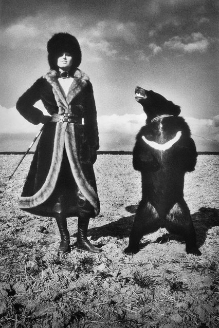Model in Fur with Bear. (Photo by Helmut Newton)