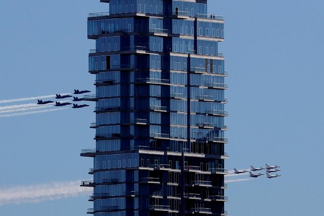 """U.S. Navy Blue Angels and U.S. Air Force Thunderbirds demonstration teams participate in a midday flyover of the New York City region as part of the """"America Strong"""" tour of U.S. cities to honor first responders and essential workers April 28, 2020. (Photo by Mike Segar/Reuters)"""