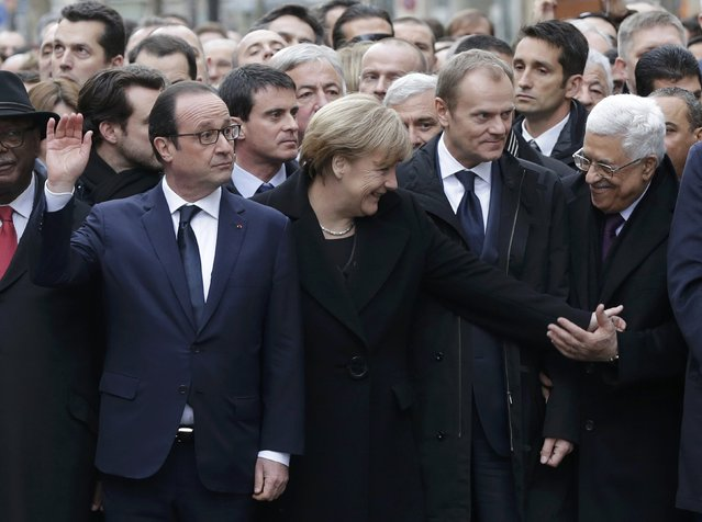 French President Francois Hollande is surrounded by heads of state including (LtoR) Germany's Chancellor Angela Merkel, European Council President Donald Tusk and Palestinian President Mahmoud Abbas as they attend the solidarity march (Marche Republicaine) in the streets of Paris January 11, 2015. (Photo by Philippe Wojazer/Reuters)