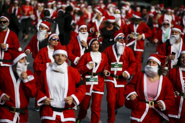 People dressed in Santa costumes take part in the Santa Claus Run in Athens, Greece, November 29, 2015. (Photo by Alkis Konstantinidis/Reuters)