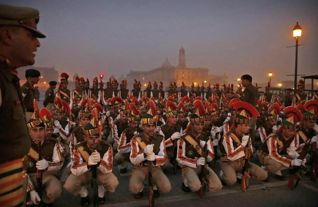 Indian paramilitary soldiers rehearse for the upcoming Republic Day parade in New Delhi, India, Thursday, January 14, 2015. (Photo by Manish Swarup/AP Photo)
