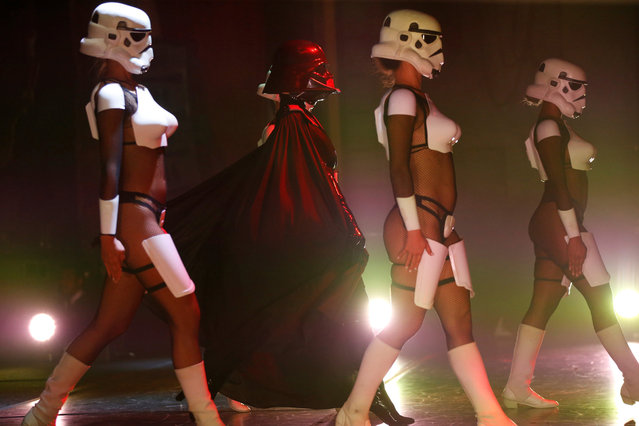 "Performers dressed like Darth Vader and Stormtroopers dance during ""The Empire Strips Back: A Star Wars Burlesque Parody"" in Los Angeles, California, U.S., June 1, 2018. (Photo by Mario Anzuoni/Reuters)"