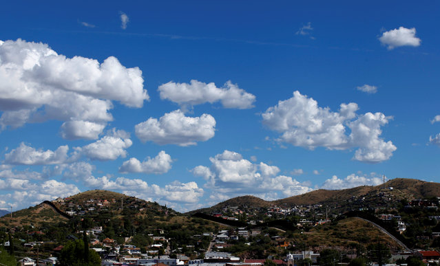 Clouds float above the border towns of Nogales, Mexico and Nogales, Arizona, United States, October 9, 2016. (Photo by Mike Blake/Reuters)