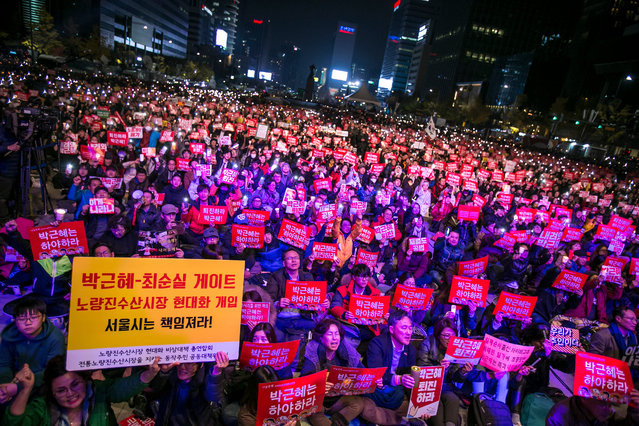 Thousands of South Koreans take to the streets in the city centre to participate in a candlelight rally to demand President Park Geun-Hye to step down on November 12, 2016 in Seoul, South Korea. Approximately tens of thousands of people joined the anti-government protest amid rising public frustration for President Park Geun-hye after a corruption scandal. (Photo by Jean Chung/Getty Images)