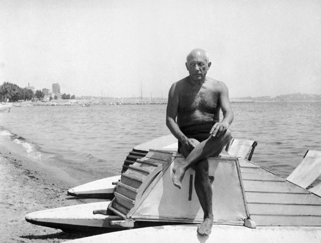 Pablo Picasso, famed 66-year-old Spanish artist who has lived most of his life in France, suns himself on a boat on the beach at Golfe Juan in Vallauris on the French Riviera on March 10, 1948. Entering a new period in his varied artistic career, Picasso has turned to painting pottery at the nearby town of Vallauris. (Photo by AP Photo)