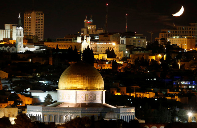 The moon is seen during a from the Dome of the Rock on the compound known to Muslims as al-Haram al-Sharif, and to Jews as Temple Mount, in Jerusalem's Old City May 12, 2016. (Photo by Ammar Awad/Reuters)