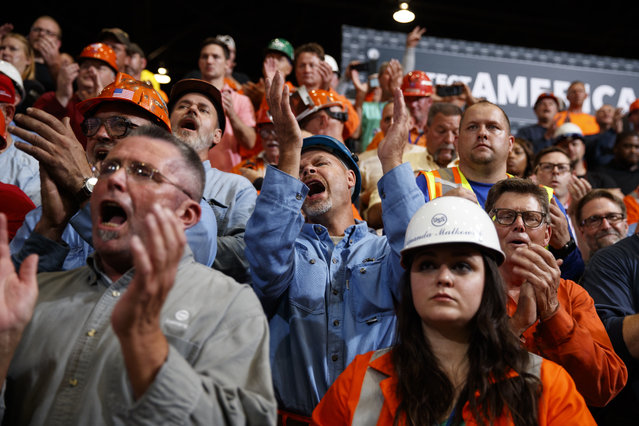 Supporters cheer as President Donald Trump speaks on trade at Granite City Works Steel Coil Warehouse, Thursday, July 26, 2018, Granite City, Ill. (Photo by Evan Vucci/AP Photo)