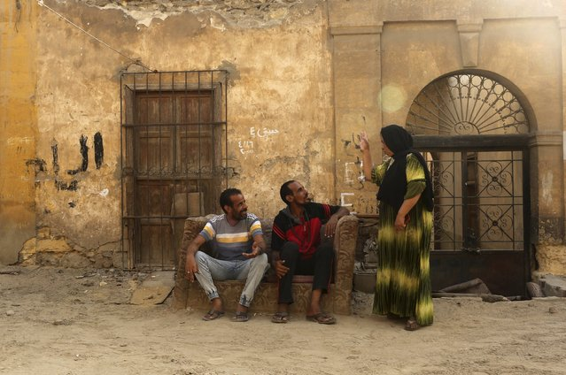 Residents talk in an alley inside the Cairo Necropolis, Egypt, September 14, 2015. (Photo by Asmaa Waguih/Reuters)