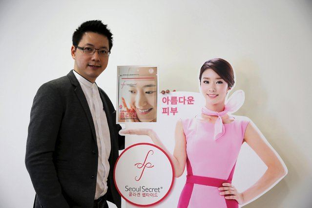 "Wattanapak Jinsirivanich, managing director of Yulihan Group (Thailand), the company that produces Seoul Secret beauty products, poses next to an ad for Seoul Secret Collagen Peptide during an interview with Reuters in Bangkok January 9, 2016. An advertisement for a skin-whitening product called ""Snowz"", made by Thai brand Seoul Secret, in Thailand has drawn criticism on social media and sparked debate over beauty ideals and advertising standards by claiming you ""need to be white to win"". (Photo by Jorge Silva/Reuters)"