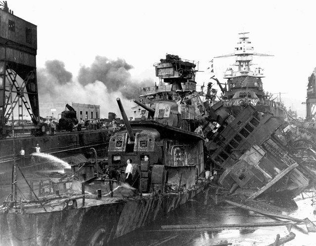 The destroyers USS Downes and USS Cassin lie wrecked in Drydock One ahead of the battleship USS Pennsylvania soon after the end of the Japanese air attack on Pearl Harbor, Hawaii, U.S. December 7, 1941. (Photo by Reuters/U.S. Navy/National Archives)