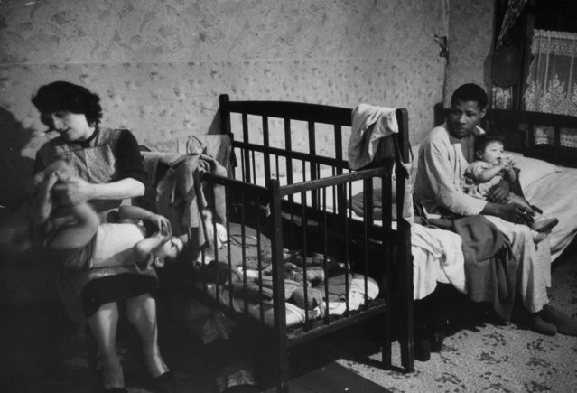 Mr Siebert Mattison, an immigrant from St Anne, Jamaica now lives, sleeps and cooks in the same room with his Welsh wife and their three children, 22nd January 1955. (Photo by Thurston Hopkins/Picture Post/Getty Images)