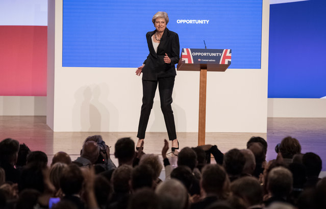 "British Prime Minister Theresa May delivers her leader's speech during the final day of the Conservative Party Conference at The International Convention Centre on October 3, 2018 in Birmingham, England. Theresa May delivered her leader's speech to the 2018 Conservative Party Conference today. Appealing to the 'decent, moderate and patriotic', she stated that the Conservative Party is for everyone who is willing to ""work hard and do their best"". This year's conference took place six months before the UK is due to leave the European Union, with divisions on how Brexit should be implemented apparent throughout. (Photo by Sean Smith/The Guardian)"