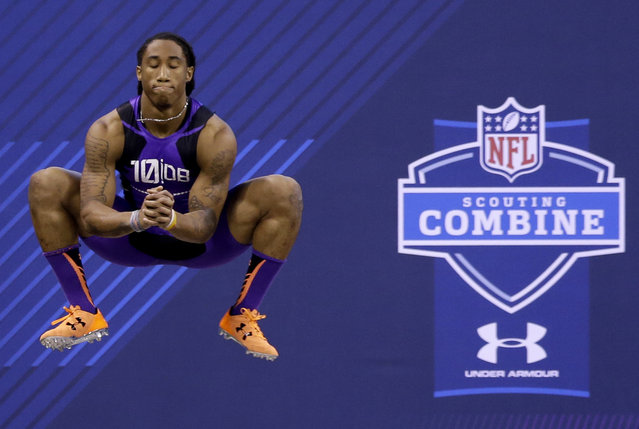 Florida State defensive back Ronald Darby jumps before running the 40-yard dash at the NFL football scouting combine in Indianapolis, Monday, February 23, 2015. (Photo by Julio Cortez/AP Photo)