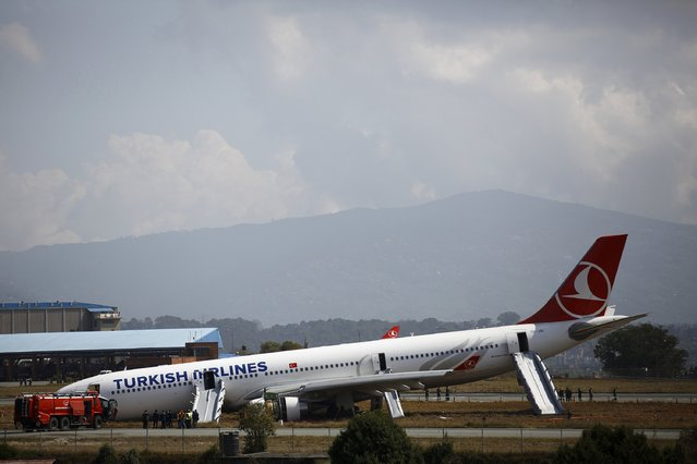 A Turkish Airlines plane lies on a field after it overshot the runway at Tribhuvan International Airport in Kathmandu March 4, 2015. According to local media, all passengers and crew members were rescued. REUTERS/Navesh Chitrakar