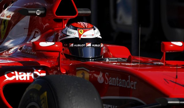 Ferrari Formula One driver Kimi Raikkonen of Finland drives in the pitlane during the second practice session of the Australian F1 Grand Prix at the Albert Park circuit in Melbourne March 13, 2015. REUTERS/Brandon Malone