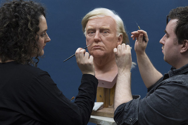 The head of the wax figure of President-elect Donald Trump is worked on by coloring supervisor, Verity Talbot, left, and senior hair technician, Luke Beard, at a studio in west London, Thursday, December 15, 2016. (Photo by Joel Ryan/Invision/AP Photo)