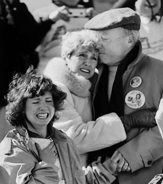 The family of Christa McAuliffe, a teacher who was America's first civilian astronaut, react shortly after the liftoff of the Space Shuttle Challanger at the Kennedy Space Center, Tuesday, January 28, 1986. Shown are Christa's sister, Betsy, front, and parents Grace and Ed Corrigan. (Photo by Jim Cole/AP Photo)