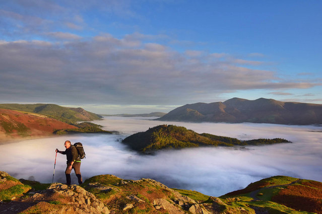 In true form, as if Poet John Keats scripted the scene morning in the Lake District, UK on October 1, 2018. The season of mists and mellow fruitfulness were observed as October arrived with a sea of mist and fog cloaking the foot of the fells surrounding Keswick and above the calm water of Derwentwater. (Photo by Paul Kingston/North News and Pictures)