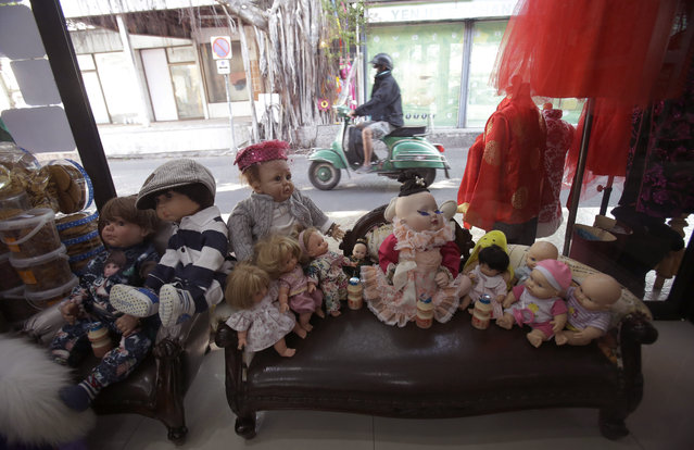 "In this Friday, January 29, 2016 photo, a collection of ""child angel"" dolls are displayed at the clothing store of their owner Supavadee Tapmalai in Bangkok, Thailand, Friday, Jan. 28 , 2016. (Photo by Sakchai Lalit/AP Photo)"