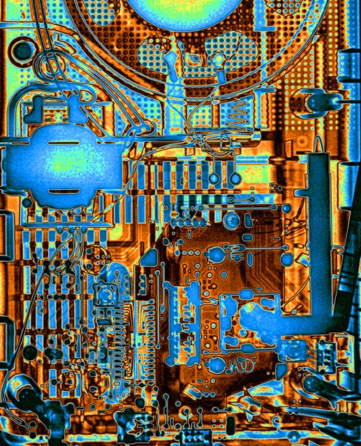 Radio circuit board, coloured X-ray. (Photo by Paula Fontaine/Barcroft Media)