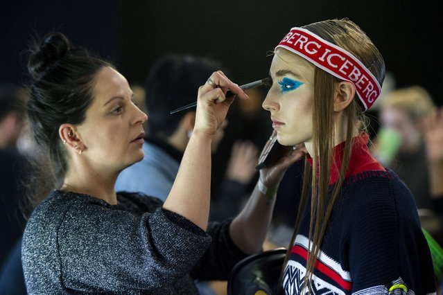 A model is being prepared backstage to present creations by Italian fashion label Iceberg during the London Fashion Week Men's, in London, Britain, 05 January 2019. (Photo by Will Oliver/EPA/EFE)