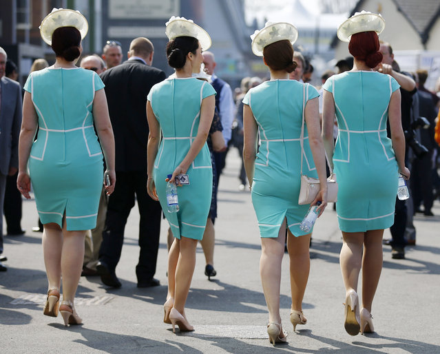 Horse Racing – Crabbie's Grand National Festival – Aintree Racecourse April 9, 2015: Women arrive for the first day. (Photo by Darren Staples/Reuters)