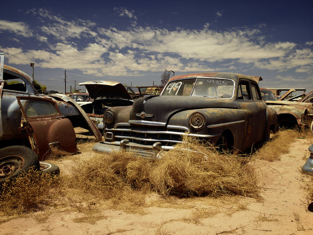 Old motors are abandoned in a dusty field in 2014, Arizona. (Photo by Dieter Klein/Barcroft Media)
