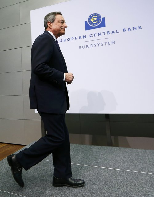 European Central Bank President Mario Draghi arrives for a news conference in Frankfurt, April 15, 2015. The news conference was disrupted on Wednesday when a woman in a black T-shirt jumped on the podium. (Photo by Ralph Orlowski/Reuters)