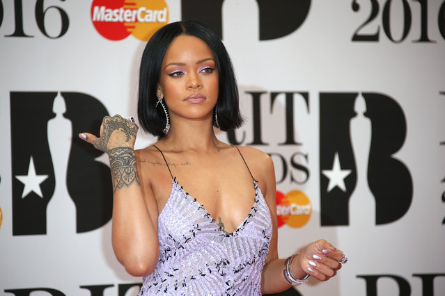 Singer Rihanna poses for photographers upon arrival for the Brit Awards 2016 at the 02 Arena in London, Wednesday, February 24, 2016. (Photo by Joel Ryan/Invision/AP Photo)