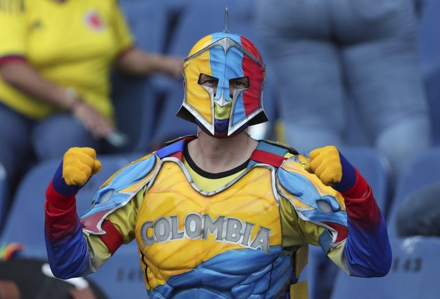 A Colombia soccer fan cheers for his team prior a qualifying soccer match for the FIFA World Cup Qatar 2022, against Argentina at the Roberto Melendez stadium in Barranquilla, Colombia, Tuesday, June 8, 2021. (Photo by Fernando Vergara/AP Photo)