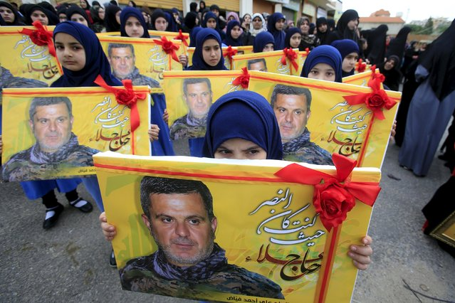 Lebanon's Hezbollah al-Mahdi girl scouts carry pictures of Ali Fayyad, one of Hezbollah's senior commanders who was killed fighting alongside Syrian army forces in Syria, during his funeral in Ansar village, southern Lebanon March 2, 2016. (Photo by Ali Hashisho/Reuters)