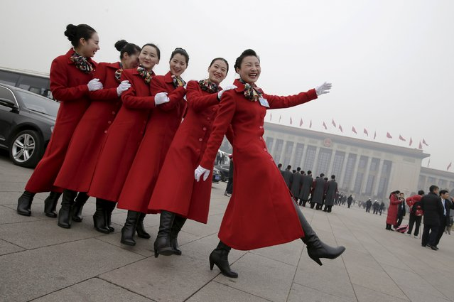 Hostesses pose for pictures outside the Great Hall of the People before a meeting ahead of Saturday's opening ceremony of the National People's Congress (NPC), in Beijing, China March 4, 2016. (Photo by Jason Lee/Reuters)