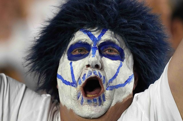 A BYU Cougars fan with makeup and a wig reacts in the second quarter against the Arizona State Sun Devils at LaVell Edwards Stadium in Provo, Utah, USA on September 18, 2021. (Photo by Kirby Lee/USA TODAY Sports)