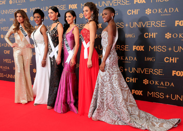 Miss Universe candidates pose for a picture during a red carpet inside a SMX convention in metro Manila, Philippines January 29, 2017. In Photo from L-R: Miss Panama Keity Drennan, Miss Cayman Islands Monyque Brooks, Miss Georgia Nuka Karalashvili, Miss U.S. Virgin Islands Carolyn Carter, Miss Netherlands Zoey Ivory and Miss Sierra Leone Hawa Kamara. (Photo by Romeo Ranoco/Reuters)