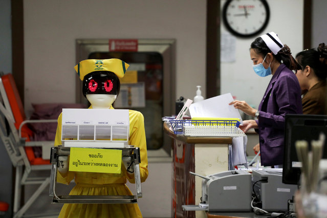 A robot wearing a nurse costume carries medical documents at Mongkutwattana General Hospital in Bangkok, Thailand, February 6, 2019. (Photo by Athit Perawongmetha/Reuters)