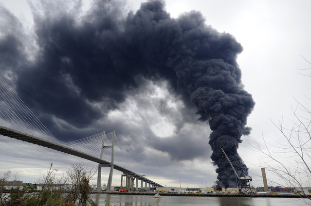 Firefighters battle a blaze in a warehouse at the Georgia Ports Authority Ocean Terminal, Saturday, February 8, 2014, in Savannah, Ga. (Photo by Stephen B. Morton/AP Photo)