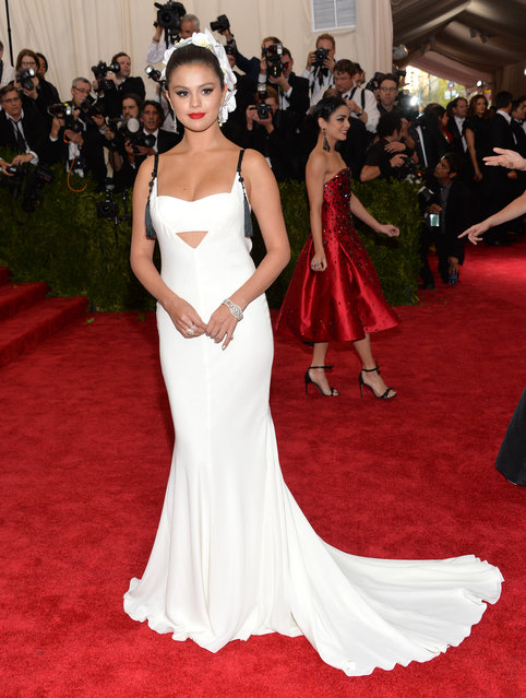 "Selena Gomez arrives at The Metropolitan Museum of Art's Costume Institute benefit gala celebrating ""China: Through the Looking Glass"" on Monday, May 4, 2015, in New York. (Photo by Evan Agostini/Invision/AP Photo)"