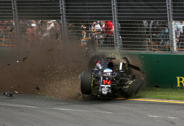 McLaren Honda's Spanish driver Fernando Alonso crashes into the wall after colliding with Haas F1 Team's Brazilian driver Esteban Gutierrez during the Formula One Australian Grand Prix in Melbourne on March 20, 2016. (Photo by Max Blyton/AFP Photo)