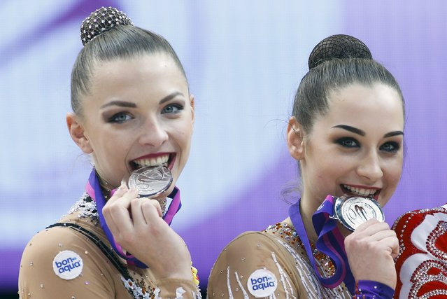 Belarus' Melitina Staniouta (L) and Katsiaryna Galkina pose with silver medals for a photo at the 31st European Rhythmic Gymnastics Championships in Minsk, Belarus, May 2, 2015. Russia won the gold, Belarus silver and Ukraine bronze in team final competition. (Photo by Vasily Fedosenko/Reuters)