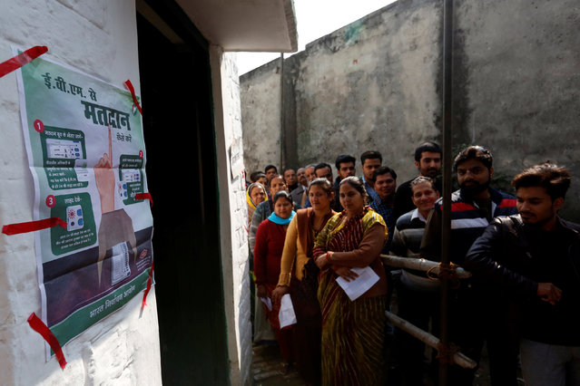 People queue to cast their vote during the state assembly election, in the town of Shamli, in the state of Uttar Pradesh, India, February 11, 2017. (Photo by Cathal McNaughton/Reuters)
