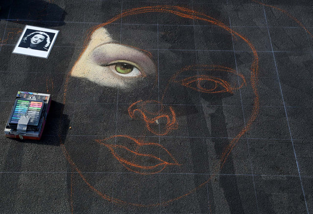 The beginning of a portrait of actress Hedy Lamar is sketched on the pavement by artist Joel Yau, of San Rafael, CA. (Photo by Greg Lovett/The Palm Beach Post)