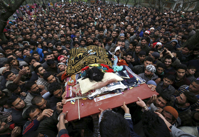 Kashmiri villagers carry the body of suspected rebel Bilal Ahmed Bhat during a funeral procession at the village of Karimabad, in the Pulwama district south of Srinagar, the summer capital of Indian Kashmir, 06 April 2016. The suspected rebel was killed on 05 April, during an encounter with security forces in a village in Gadoora Pulwama in southern Kashmir. (Photo by Farooq Khan/EPA)